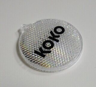 Plastikust helkur logoga - KOKO